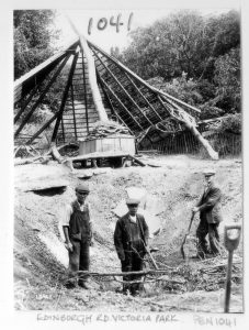 Three men stand in crater of the bomb that destroyed the summerhouse circa 1941 image courtesy of Portsmouth Museums